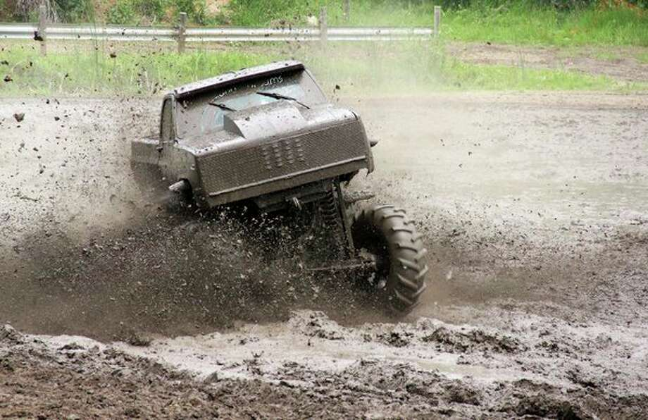 A truck recently tears it's way through the mud pit at Silver Bullet Speedway. (Andrew Mullin/Huron Daily Tribune)