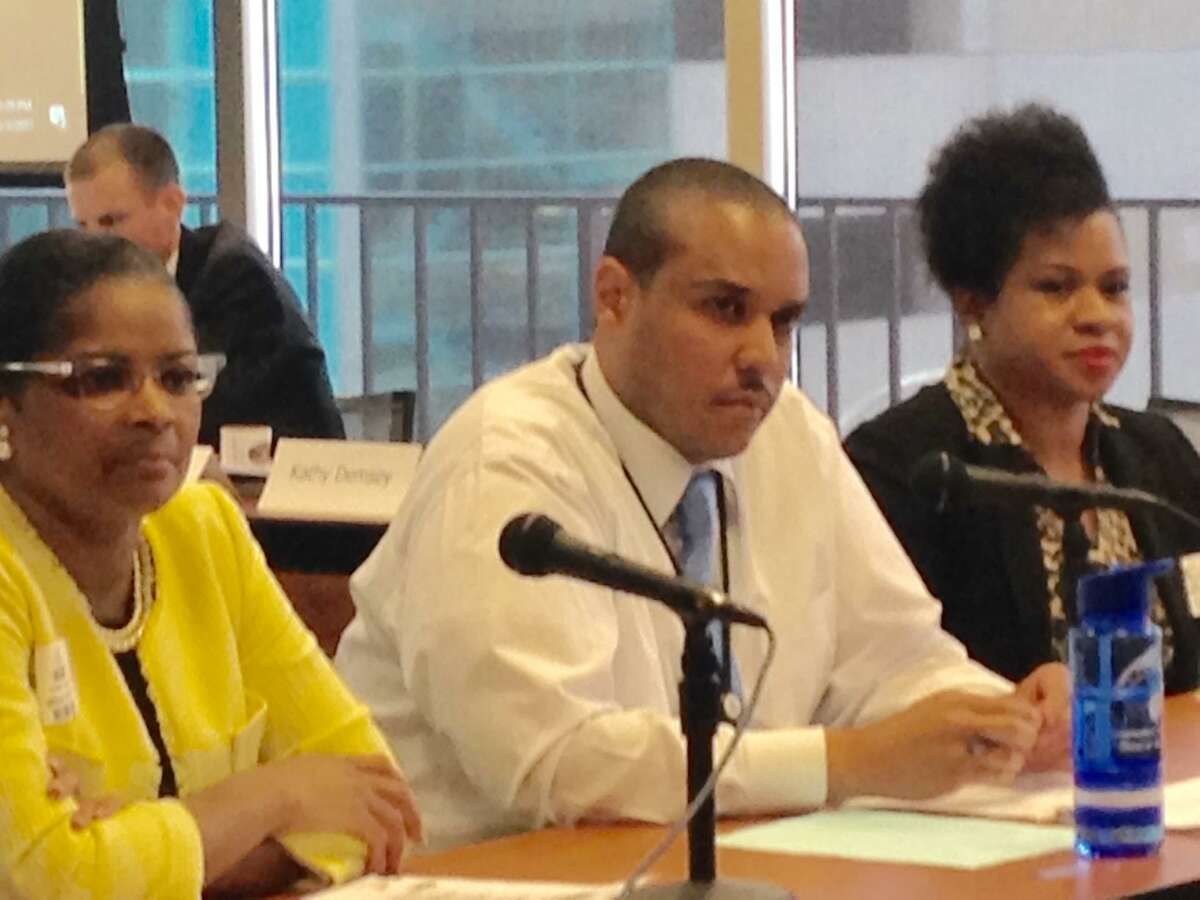 Schools Superintendent Aresta Johnson and Dunbar Principal present before the state Board of Education with State Turnaround Officer Desi Nesmith