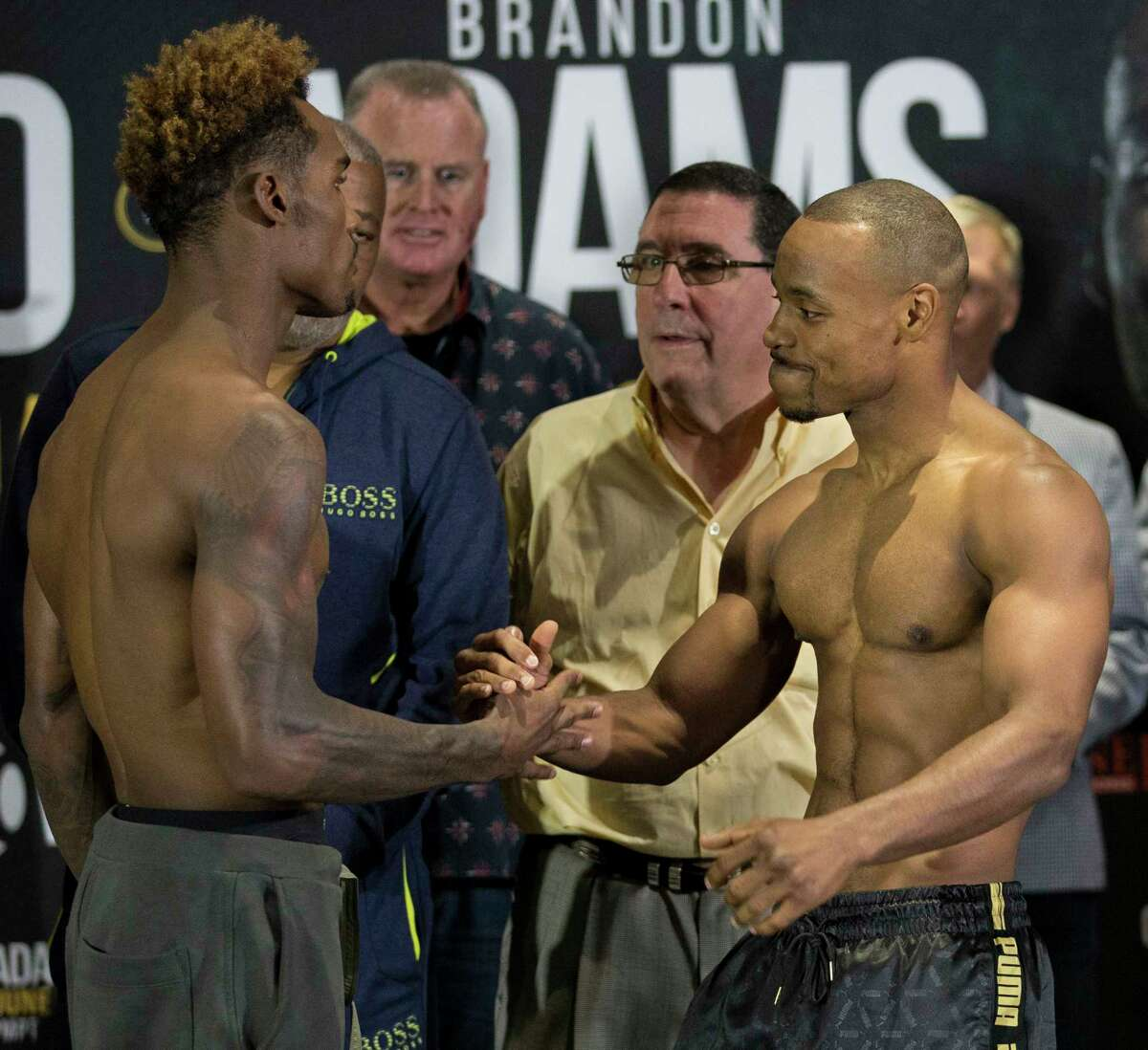 WBC middleweight challenger Brandon Adams, right, gives unbeaten interim champion Jermall Charlo a hug after stare-down at NRG Center on Friday, June 28, 2019, in Houston. The two will fight each other 12 rounds at NRG Arena Saturday night.