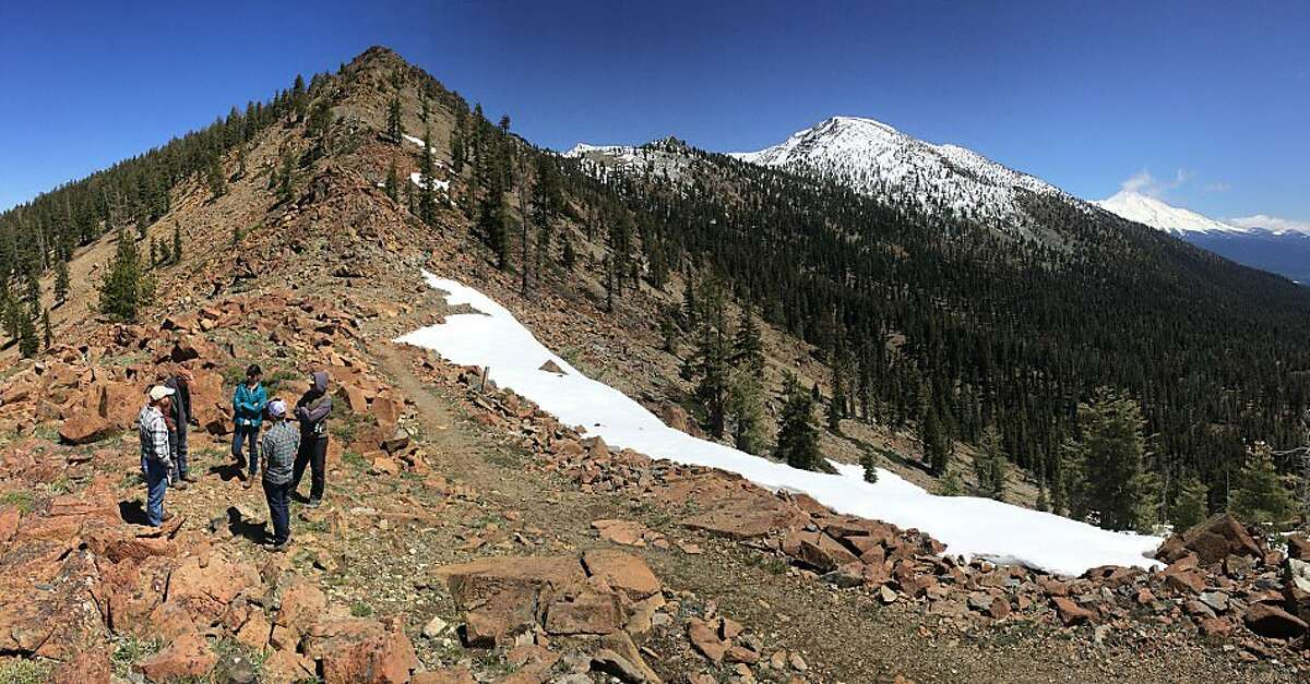 A scene of people atop a ridge on the Trinity Divide property in the Trinity Mountains.