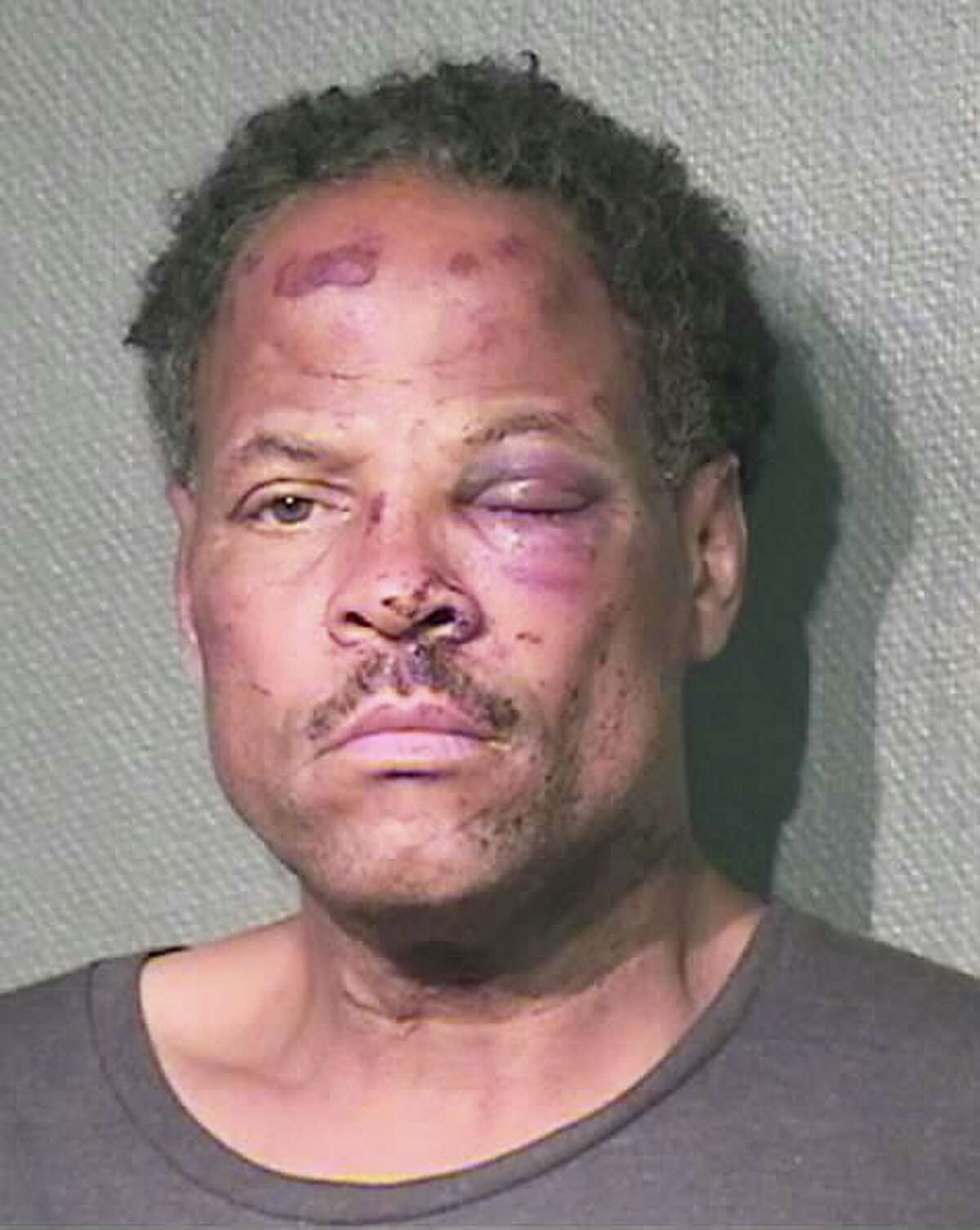 Dwayne Walker's booking shot in 2017, after Houston Police Department officer Shane Privette repeatedly kneed him in side and face after authorities said he tried to flee.