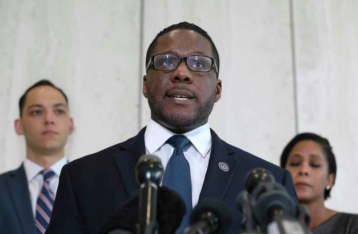 Civil Rights Division attorneys Michael Harrison, center, Gavin Ellis and Natasha Sinclair of the Harris County District Attorney's Office answering questions about the indictment of Officer Shane Privette on Thursday, June 27, 2019, in Houston. Privette allegedly hit Dwayne Walker in the face with his knee outside a gas station during an arrest on Nov. 14, 2017. A grand jury indicted Privette Wednesday.