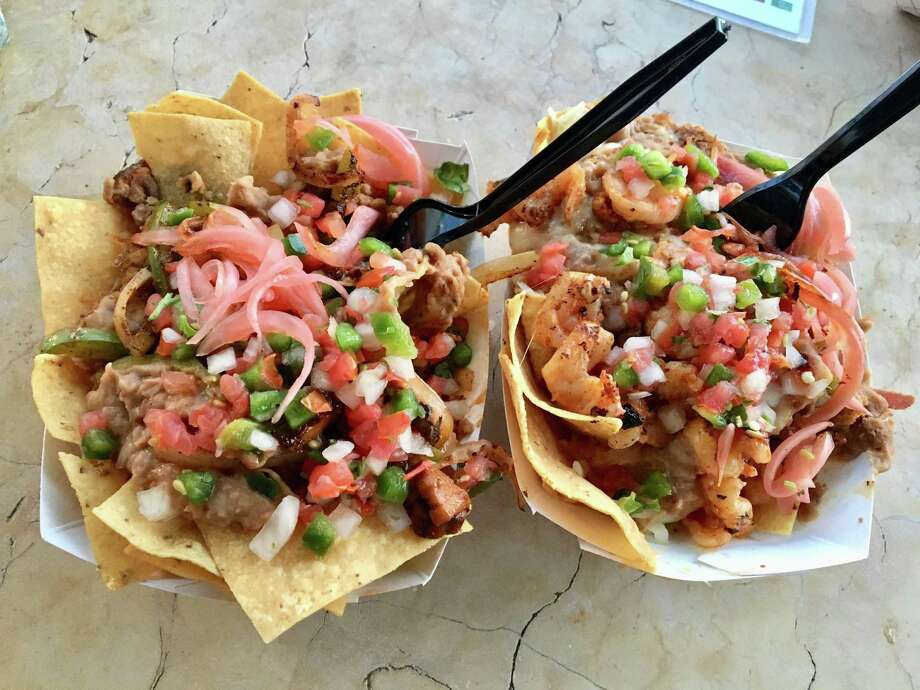 "Sanchos has a selection of 11 kinds of nachos, including the vegan ""faux""-jita (left) and camaron (shrimp). Photo: Scott Huddleston / Staff"