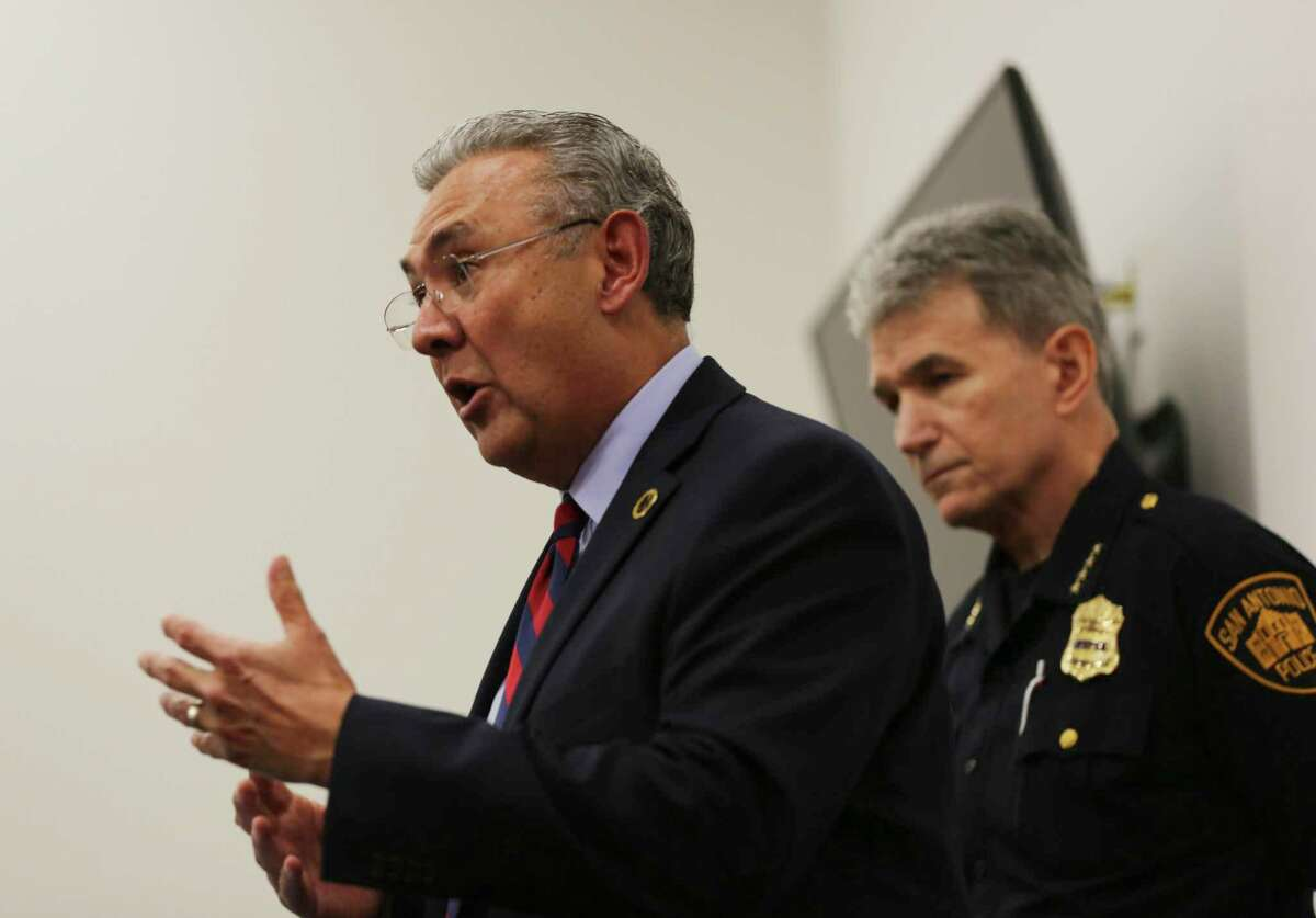 Bear County District Attorney Joe Gonzales, left, describes a new program that gives police officers the discretion to issue citations to people for low-level crimes rather than arrest them. He spoke at the news conference June 28, 2019, at the Bexar County Reentry Center in San Antonio. San Antonio Police Chief William McManus, right, supports the program, saying it will free up police officers' time to pursue more serious crime.