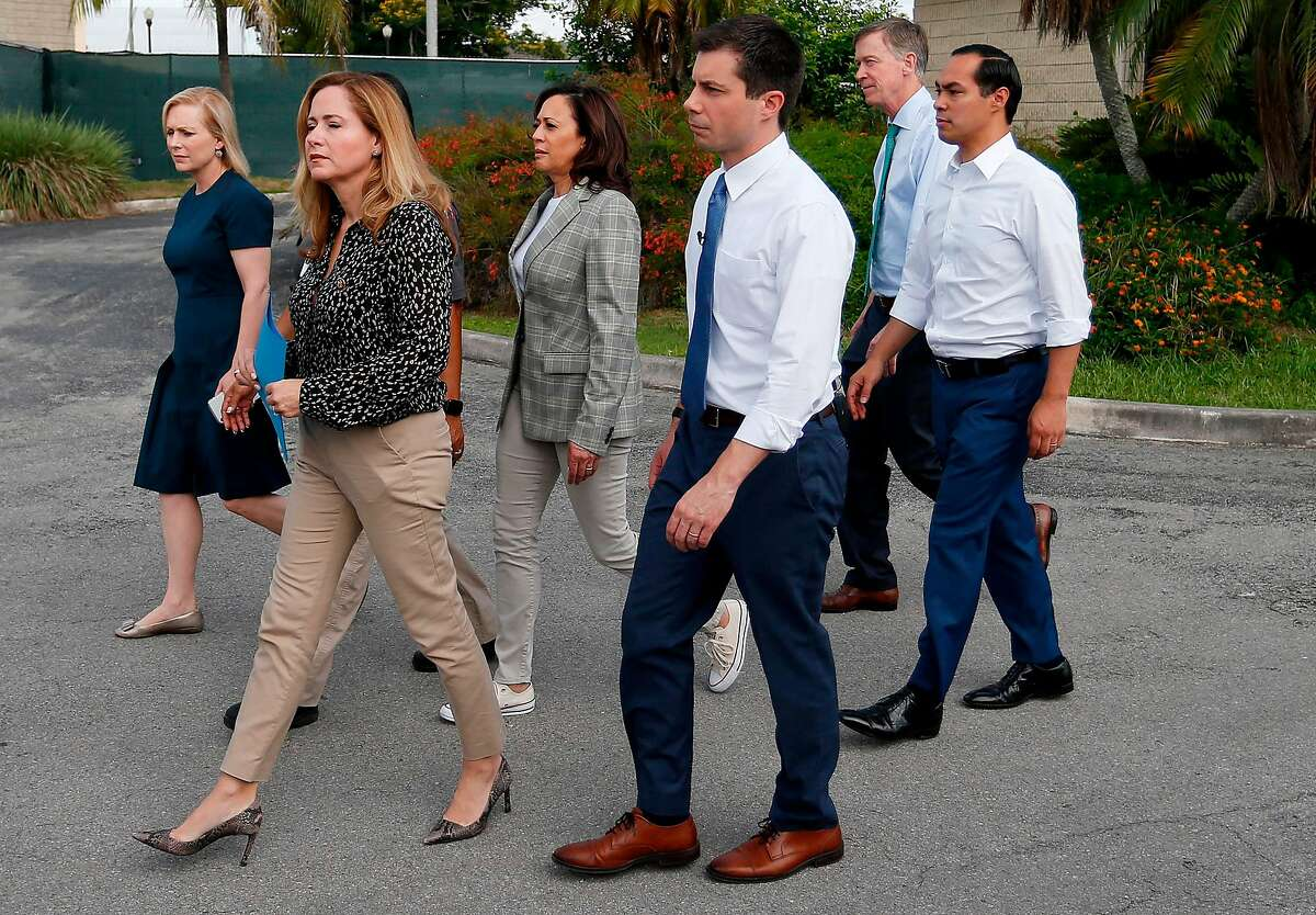 Democratic presidential hopefuls Kirsten Gillibrand (L), Kamala Harris (3rd L), John Hickenlooper (2nd R), Julian Castro (R) and Pete Buttigieg (3r R), along with Florida Congresswoman Debbie Mucarsel-Powell,exit the office where migrant children are being in a detention center in Homestead, Florida on June 28, 2019. They were denied entry. (Photo by RHONA WISE / AFP)RHONA WISE/AFP/Getty Images