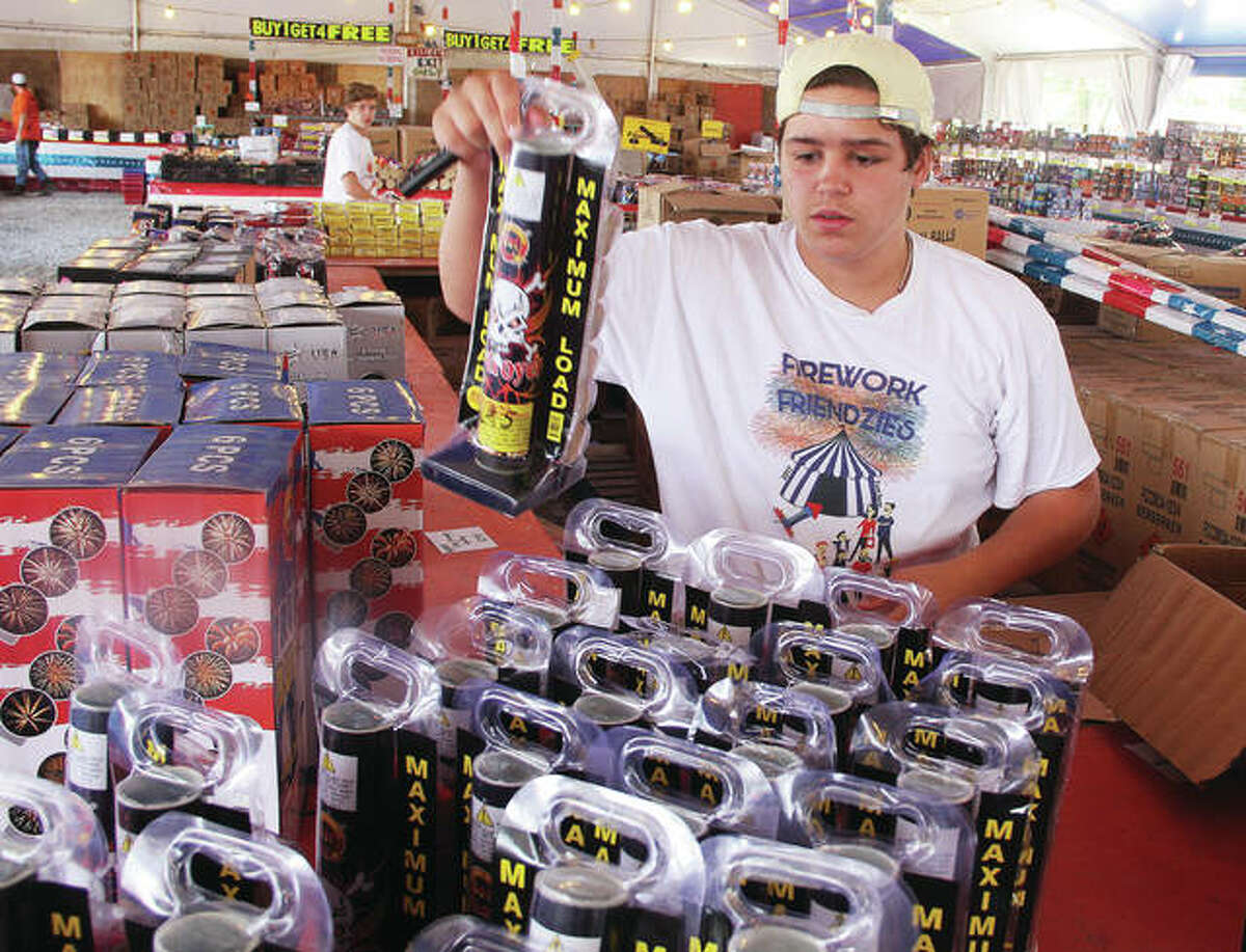 Owen Thomeczek stocks canister shells at Fireworks City, located at the intersection of U.S. 67 and Missouri Highway 94 in West Alton. The store opened a few days later than normal because of flooding but, so, is the only fireworks store open between the Lewis and Clark bridges, an area sometimes known as Gunpowder Alley. Most of the other traditional fireworks sales locations are still under water.