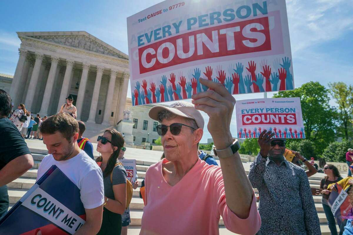 Immigration activists rally outside the Supreme Court as the justices hear arguments over the Trump administration's plan to ask about citizenship on the 2020 census, in April. Voting rights activists argue that newly discovered 2015 correspondence between a GOP redistricting expert and a current Census Bureau official bolster arguments that discrimination motivated efforts to add a citizenship question to the 2020 population survey.