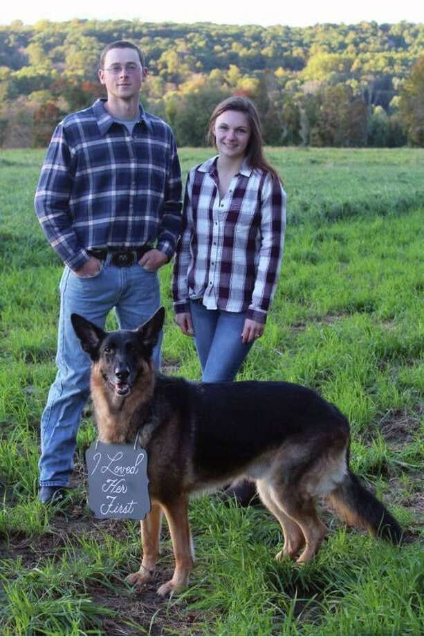 "Crystal Elizabeth Bazyk and Charles ""Chad"" David Ferris V pose with their dog. Photo: Contributed Photo"