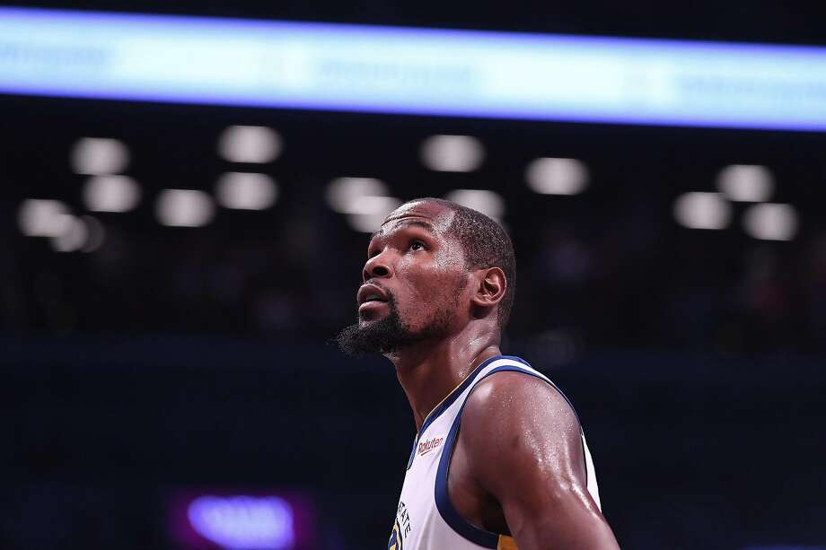 NEW YORK, NY - OCTOBER 28: Kevin Durant #35 of the Golden State Warriors during the game against the Brooklyn Nets at Barclays Center on October 28, 2018 in the Brooklyn borough of New York City. A new book from Warriors reporter Ethan Strauss covers the Warriors during the 2010s. Photo: Matteo Marchi, Getty Images