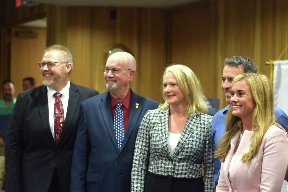 Jenny McGown (right), stands with Klein ISD board members Ronnie Anderson, Julie Benes, Rick Mann and Chris Todd after being chosen to be the new superintendent of Klein ISD.