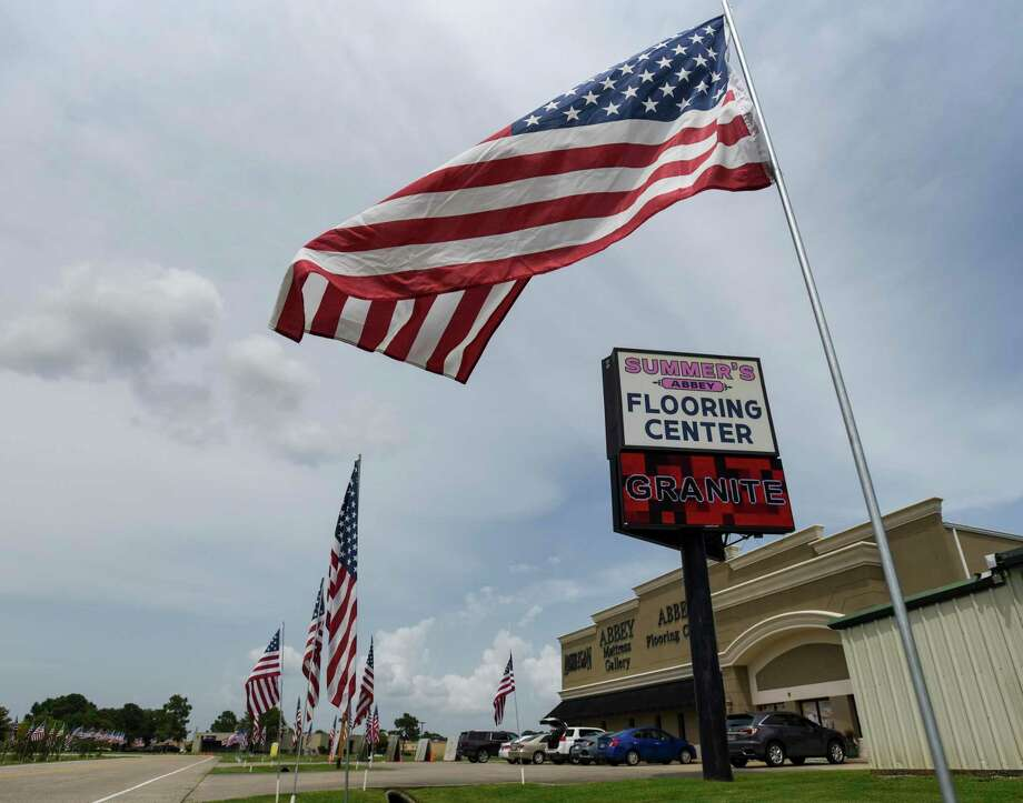American flags line the road outside Summer's Abbey flooring center in Port Neches Thursday afternoon. The store is handing out free American flags to anyone who comes to their store. Photo taken on Tuesday, 6/27/19. Ryan Welch/The Enterprise Photo: Ryan Welch, Beuamont Enterprise / The Enterprise / © 2019 Beaumont Enterprise