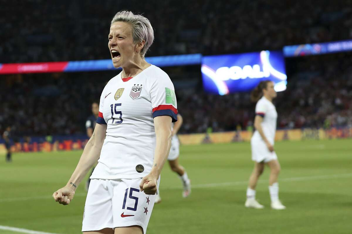 United States' Megan Rapinoe celebrates after scoring her side's second goal during the Women's World Cup quarterfinal soccer match between France and the United States at the Parc des Princes, in Paris, Friday, June 28, 2019. (AP Photo/Francisco Seco)