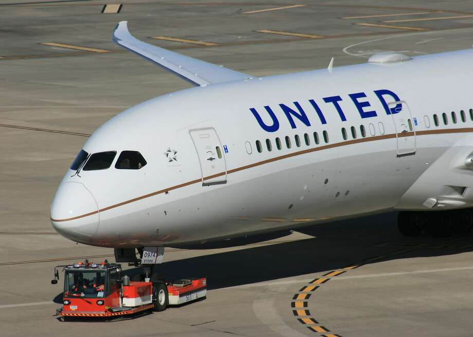 A United Airlines is towed to a gate atBush Intercontinental Airport. Photo: Bill Montgomery, Houston Chronicle