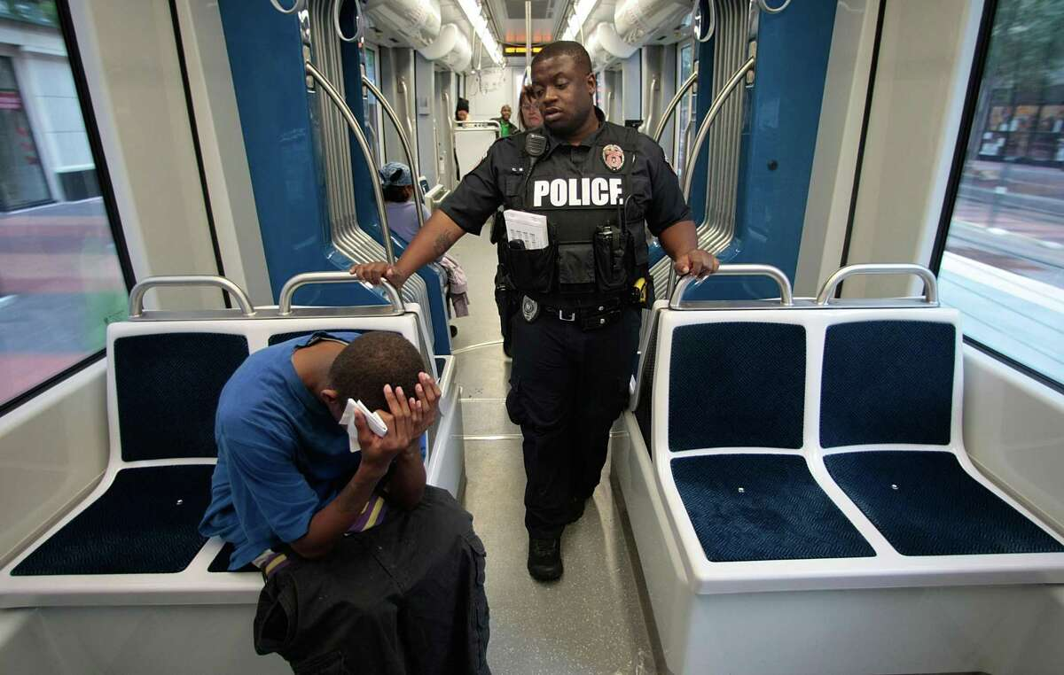 Metropolitan Transit Authority Police officer C. Washington talks to a rider about not having paid for his fare before getting on the on May 15, 2013.