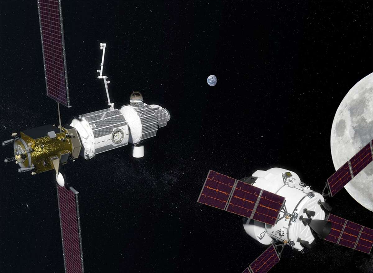 An artist's conception shows the Deep Space Gateway in the vicinity of the moon, with an Orion crew vehicle nearby.
