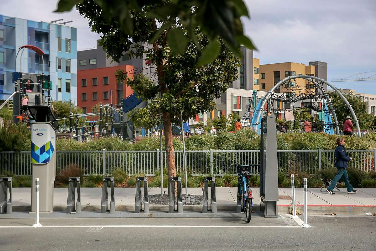 A nearly empty bicycle station near Mission Bay Kids Park on Long Bridge Street Thursday, June 27, 2019, in Morgan Hill, Calif. Lyft is wrangling with with San Francisco Municipal Transportation Agency in court and as they work through a contract dispute, docks for the new electric bikes are empty while Lyft�s new electric bikes sit in a warehouse yet to be used.