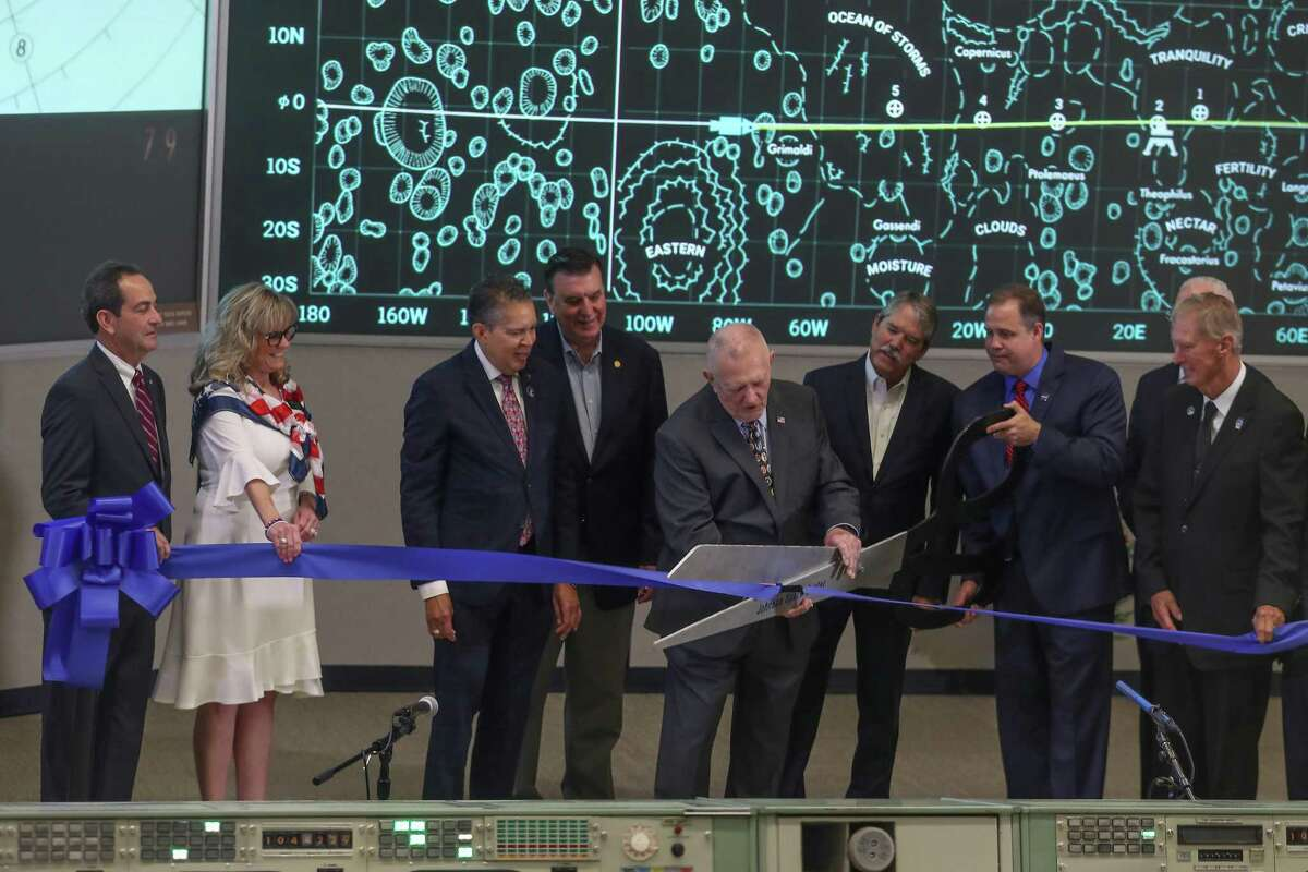 Apollo Flight Director Gene Kranz and NASA Administrator Jim Bridenstine cut a ceremonial ribbon as NASA Johnson Space Center and Space Center Houston unveiled the newly restored mission control room Friday, June 28, 2019, in Houston.