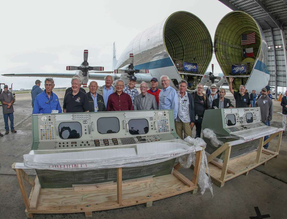 Apollo Alumni members have their photos taken by restored Historic Mission Control consoles at Ellington Field Thursday, Nov. 8, 2018, in Houston. NASA's Super Guppy transported the consoles from the Cosmosphere in Hutchinson, Kansas.