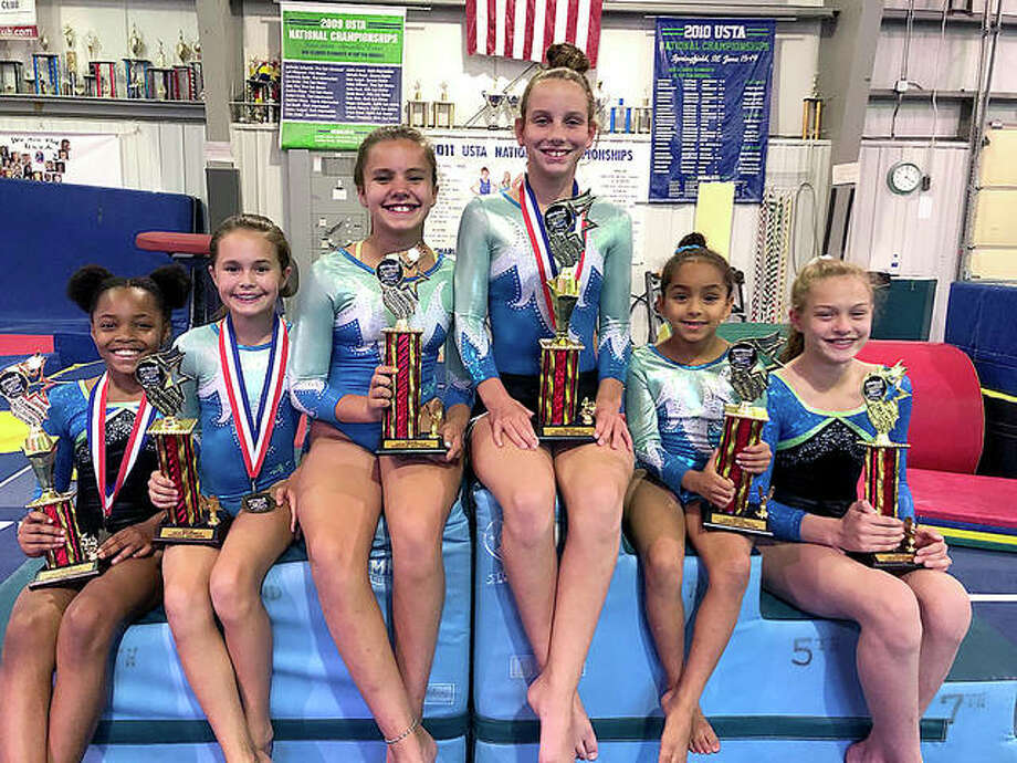 Six Mid-Illinois gymnasts placed in the trophy round of the USTA National Tumbling Championships last week in Charleston, West Virginia. All received high placements in the medal rounds and captured flight awards. They later received trophies for top 10 placement. Winners were, from left, Jaylee Evans fifth in intermediate age 11, Ellie Enos eighth in Sub Novice age 11, Sofia Moehn eighth in Sub Novice age 10, Sidney Ufert fourth in Intermediate age 11 and Caroline Cain 10th in Sub Advanced age 11-12. Most age groups included five to six flights of 10 athletes. Photo: Submitted Photo