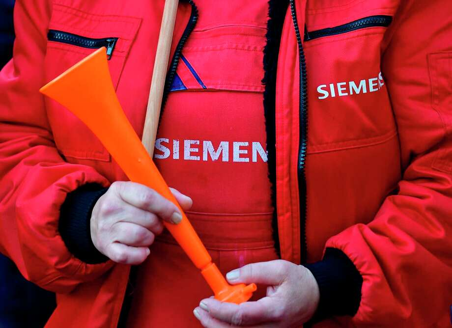 The German industrial conglomerate Siemens has cut more than 200 jobs in Houston since the end of 2018. Photo: TOBIAS SCHWARZ, Contributor / AFP/Getty Images / AFP or licensors