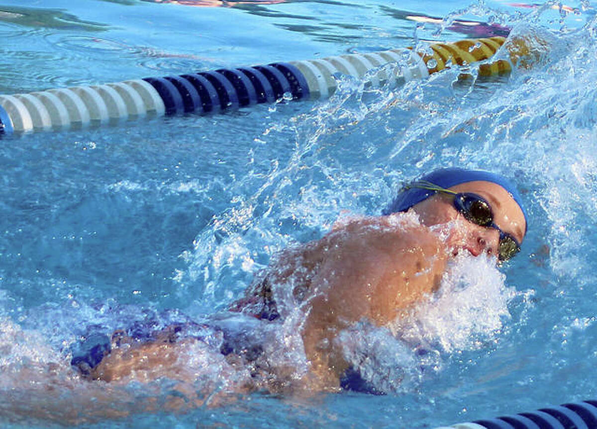 Anna Moehn of the Summers Port Sharks was a triple winner at Thursday's SWISA meet in Godfrey against the splash City Gators of Collinsville.