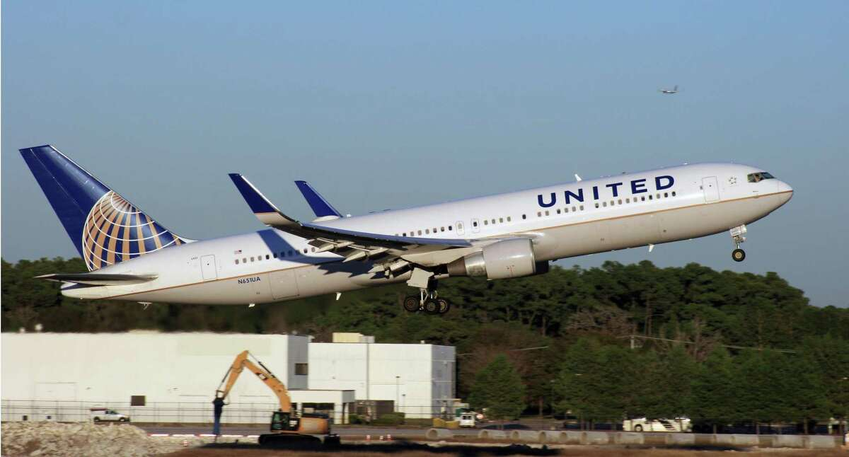A United Airlines Boeing 767 takes off from Bush Intercontinental Airport.