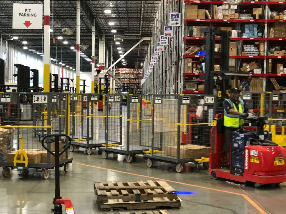 Amazon's mammoth Brookshire Fulfillment Center employs about 1,000 people and keeps moving deliveries from one place to another to customers in the shortest time possible. Photo: Mike Glenn / Staff Photo