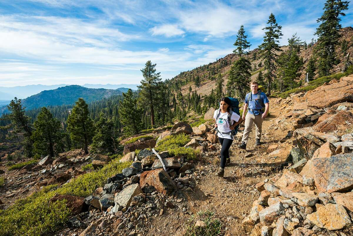 A pair of thru-hikers on the Pacific Crest Trail near Bull Lake in Northern California.