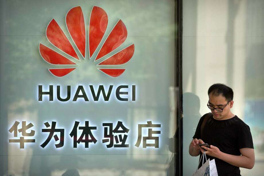 A reader thinks it's criminal for U.S. companies to continue business with Huawei despite Trump's sales ban. Photo: Mark Schiefelbein /Associated Press / Copyright 2019 The Associated Press. All rights reserved