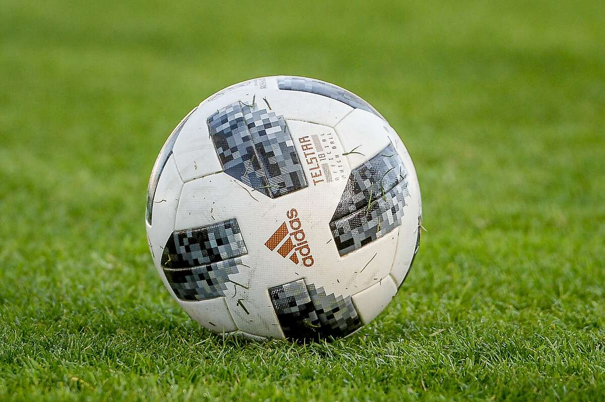 An official Addidas soccer ball is seen prior to a women's match