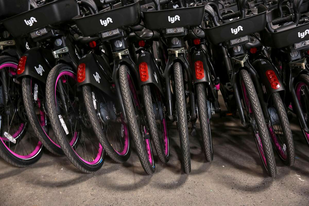 Brand new stationless Lyft electric bikes sit inside Lyft�s warehouse in Dogpatch Thursday, June 27, 2019, in Morgan Hill, Calif. Lyft is wrangling with with San Francisco Municipal Transportation Agency in court and as they work through a contract dispute, docks for the new electric bikes are empty while Lyft�s new electric bikes sit in a warehouse yet to be used.
