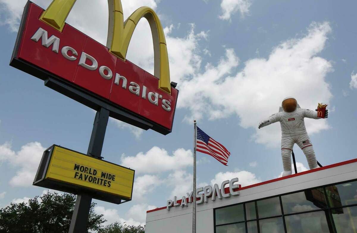 An astronaut sits on top of a McDonald's, 1421 NASA Road 1 on June 28, 2019, in Webster.