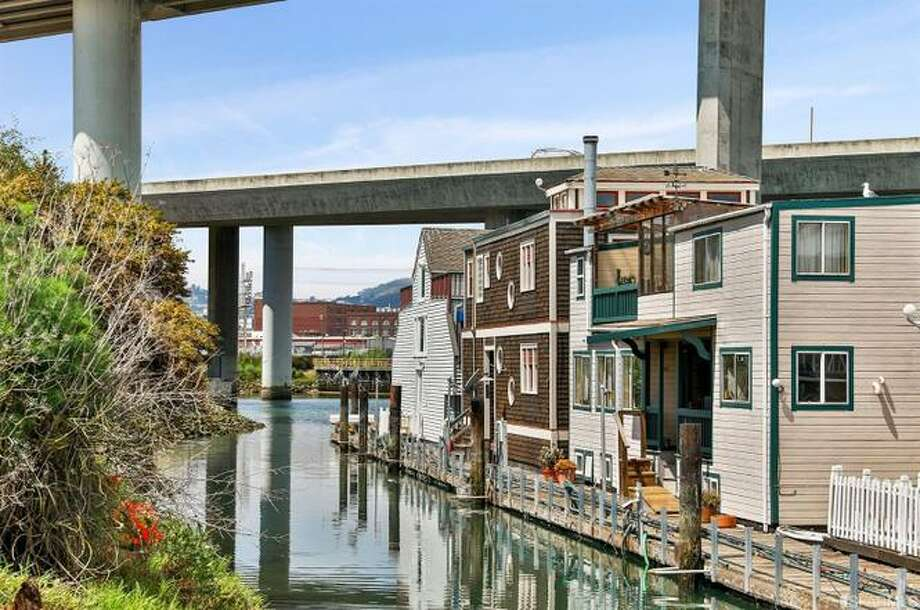 One of only 20 floating homes on San Francisco's Mission Creek, this 2,200-square-foot home with an Arts and Crafts flair is listed for $1.8 million.