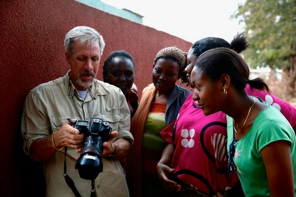 Photographer Chris Martin shows his images to parents at the Sinai Primary School in Babati, Tanzania. (Submitted photo)