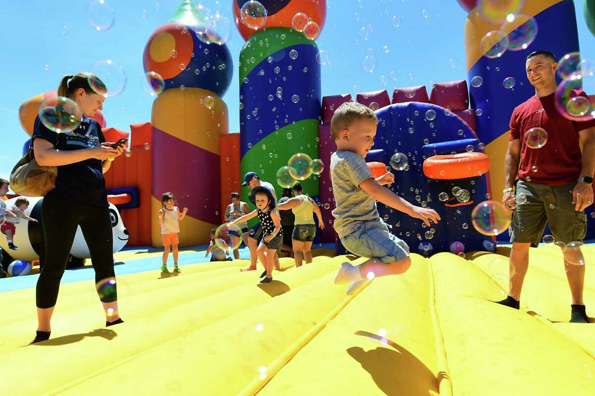 Parents and kids have fun together as The Big Bounce AmericaOs 2019 tour is held at Ellms Family Farm on Friday, June 28, 2019 in Ballston Spa, N.Y. (Lori Van Buren/Times Union)