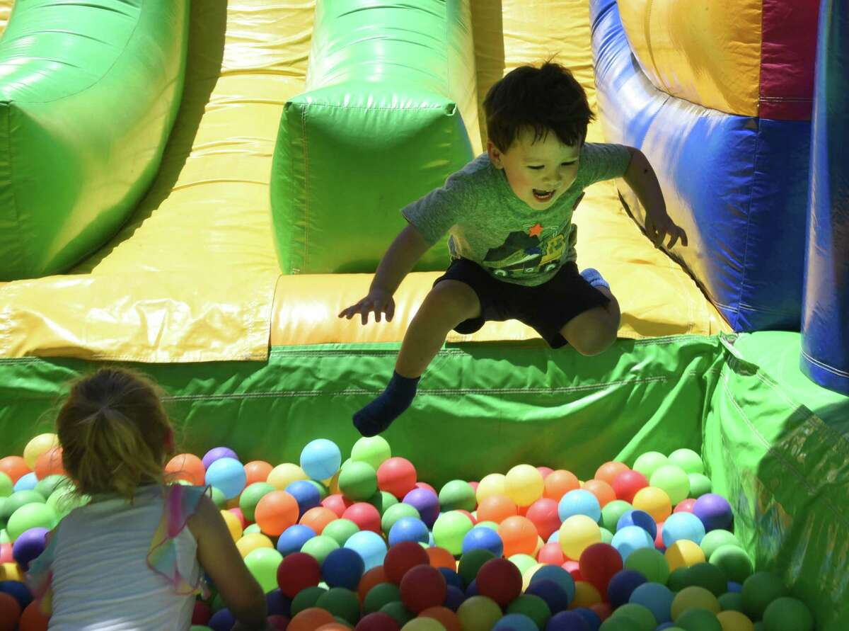 Andrew, 2, of Ballston Spa jumps into a pit of balls after sliding down a giant slide as The Big Bounce America?s 2019 tour is held at Ellms Family Farm on Friday, June 28, 2019 in Ballston Spa, N.Y. (Lori Van Buren/Times Union)