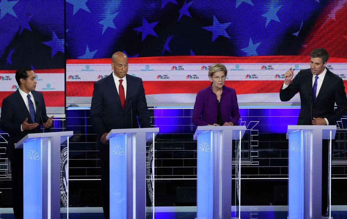 Former housing secretary Julian Castro, Sen. Cory Booker (D-NJ) and Sen. Elizabeth Warren (D-MA) look on as former Texas congressman Beto O'Rourke speaks during the first night of the Democratic presidential debate on June 26, 2019 in Miami, Florida.