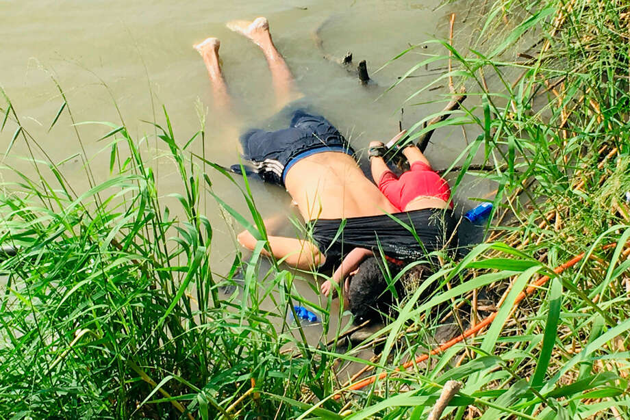 The bodies of Salvadoran migrant Oscar Alberto Martínez Ramírez and his nearly 2-year-old daughter Valeria lie on the bank of the Rio Grande in Matamoros, Mexico, Monday, June 24, 2019, after they drowned trying to cross the river to Brownsville, Texas. Martinez' wife, Tania told Mexican authorities she watched her husband and child disappear in the strong current. This photograph was first published in the Mexican newspaper La Jornada. (AP Photo/Julia Le Duc) Photo: Julia Le Duc
