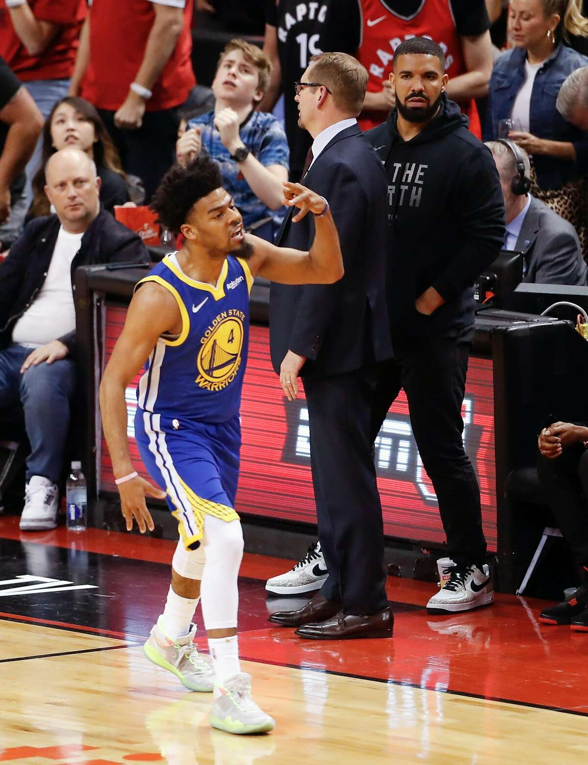 FILE - Golden State Warriors' Quinn Cook reacts after hitting a three-pointer in the fourth quarter during game 2 of the NBA Finals between the Golden State Warriors and the Toronto Raptors at Scotiabank Arena on Sunday, June 2, 2019 in Toronto, Ontario, Canada.