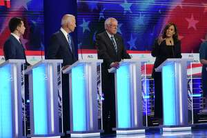 Former Vice President Joe Biden, second from left, listens to Sen. Kamala Harris (D-Calif.) speak about her personal experience and his opposition to school busing in the 1970s during the Democratic presidential debate in Miami on Thursday night, June 27, 2019. At center is Sen. Bernie Sanders (I-Vt.) and at left is Mayor Pete Buttigieg of South Bend, Ind. Trump campaign aides and allies acknowledged that the California senator could be a vexing rival and that the Democratic race will be more unpredictable than they had thought. (Doug Mills/The New York Times)