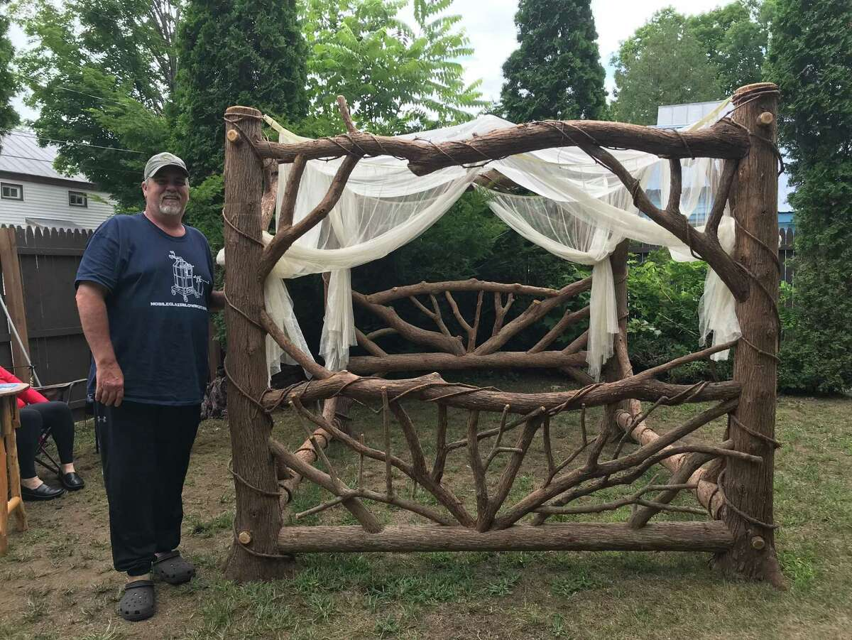 William Betrus and his wife Elaine, of Saranac, began Adirondack Custom Twig in 1998 as a family run business, specializing in ornate Adirondack style twig work. They create pieces for bedrooms, kitchens, the outdoors, or great rooms. He is one of the featured artists at the the 2019 Northville Rotary Club's annual woodworking and fine arts weekend on July 19-21. (Photo provided)