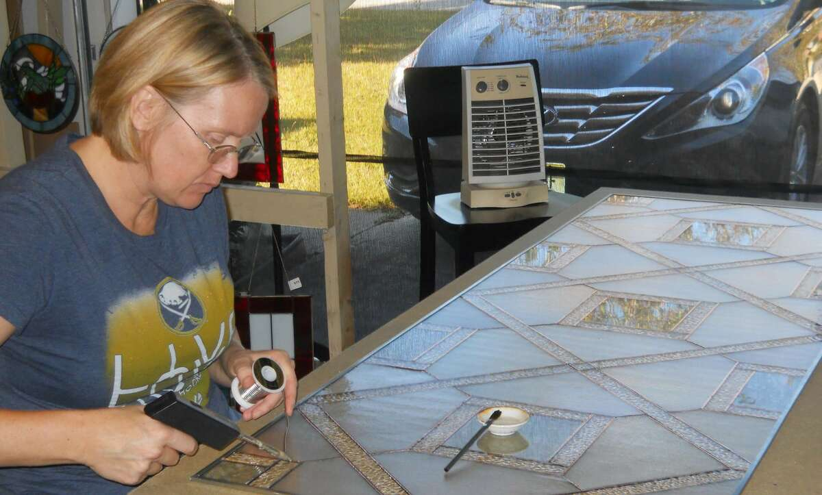 Carolyn Adamczyk owns Silver Maple Stained Glass. Her art is often taken from the nature that surrounds her. She is one of the featured artists at the the 2019 Northville Rotary Club's annual woodworking and fine arts weekend on July 19-21. (Photo provided)