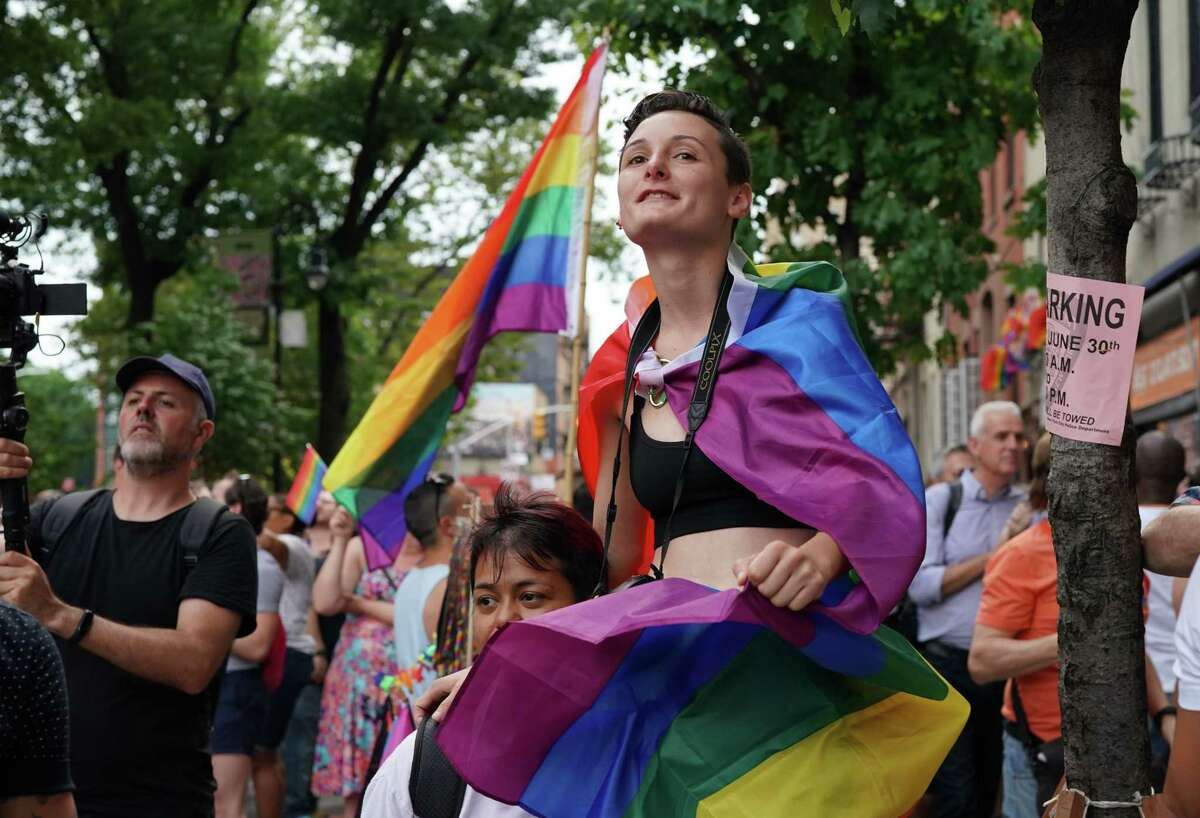 Cylina Case and Beatrice Nava from California join people as they mark the 50th anniversary of the Stonewall Riots near the Stonewall Inn in New York, June 28, 2019. - The June 1969 riots, sparked by repeated police raids on the Stonewall Inn -- a well-known gay bar in New York's Greenwich Village -- proved to be a turning point in the LGBTQ community's struggle for civil rights. (Photo by TIMOTHY A. CLARY / AFP)TIMOTHY A. CLARY/AFP/Getty Images