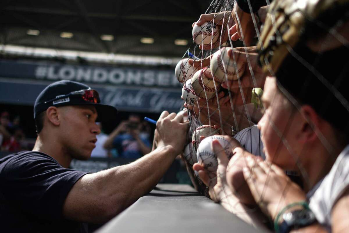 LONDON, ENGLAND - JUNE 28: Aaron Judge, New York Yankees, signs autographs at The London Stadium on June 28, 2019 in London, England. The New York Yankees are playing the Boston Red Sox this weekend in the first Major League Baseball game to be held in Europe. (Photo by Peter Summers/Getty Images)
