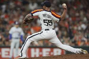 Houston Astros relief pitcher Ryan Pressly (55) pitches during the eighth inning of a major league baseball game at Minute Maid Park on Friday, June 28, 2019, in Houston.