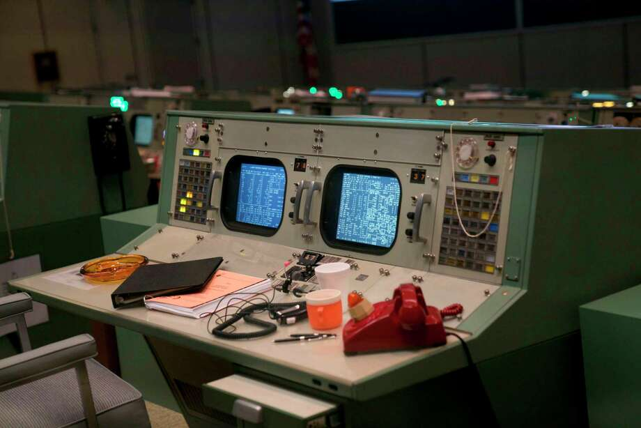 Original items which were acquired and reproduced, including phones, ashtrays and coffee mugs, are displayed at the newly restored Apollo Mission Control Room at NASA's Johnson Space Center in Houston on June 28, 2019. - 50 years after handling the Apollo 11 mission, NASA's Apollo mission control center has been restaured to appear just as it did back then. (Photo by Kacey Cherry / AFP)KACEY CHERRY/AFP/Getty Images Photo: KACEY CHERRY, Contributor / AFP/Getty Images / AFP or licensors