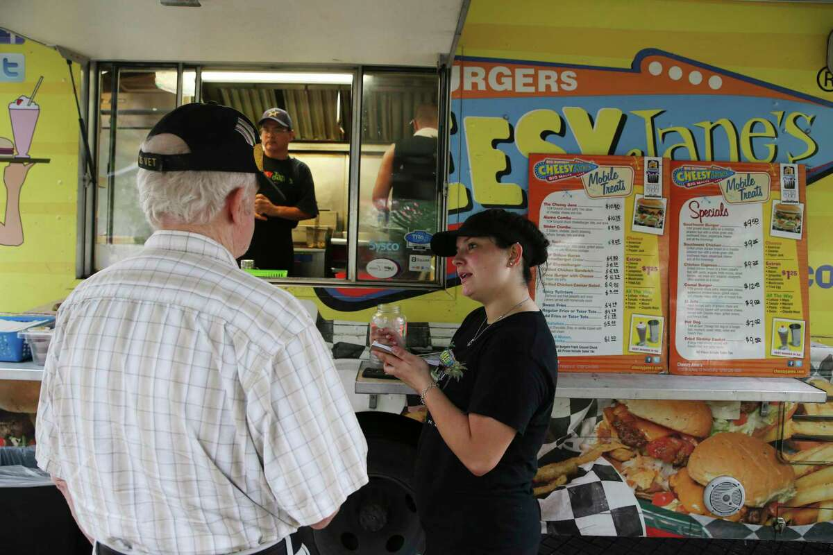 Sierra Williams takes an order at Cheesy Jane's food truck parked at Main Plaza on June 24, 2019. Cheesy Jane's won first place for best food truck.