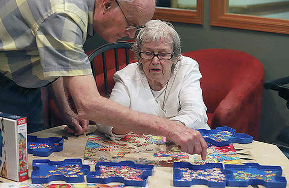 Dennis Burleyson and Betty Geisler piece together a puzzle at The Glenwood Supportive Living of Mount Zion. The creations are such an accomplishment that many are displayed throughout the facility. Photo: Jim Bowling | Herald & Review (AP)