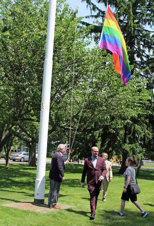 First Selectman Tetreau invited queer-identifying Fairfield citizens to help raise the pride flag. Photo: Rachel Scharf / Hearst Media Connecticut