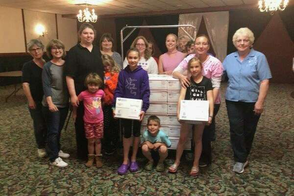 Girl Scout Troop #50238, North Huron, recently helped the Blue Star Mothers Thumb Chapter pack 178 boxes for our military. The Girl Scouts donated Girl Scout cookies to add to the boxes. The evening was fun for all involved. (Submitted Photo)